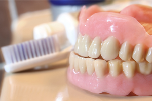 Dentures, known as 'false teeth' are prosthetic devices which are worn to replace missing teeth
